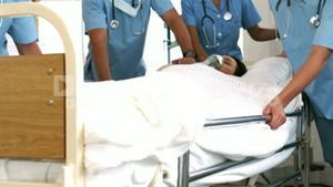Team of doctor resuscitating a patient