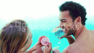 Attractive couple relaxing by the pool