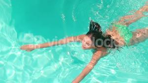 Attractive woman swimming in the pool
