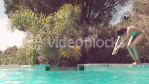 Attractive woman diving in the pool