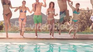 Happy friends diving together in the pool
