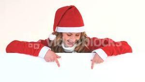Young blonde woman dressed up as Santa Claus