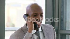 Wealthy businessman talking on a phone