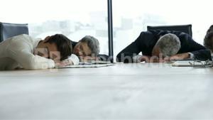 Business people sleeping on table