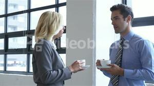 Business colleagues having coffee