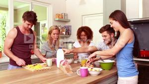 Friends talking while eating breakfast together