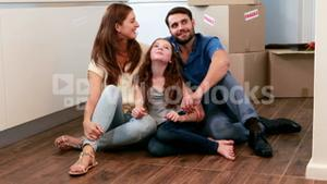 Happy family sitting on the floor