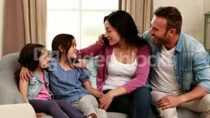 Happy family talking on the sofa