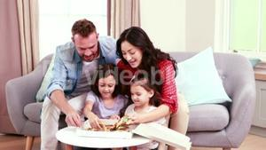 Smiling father bringing pizza for family