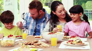 Happy family eating lunch together