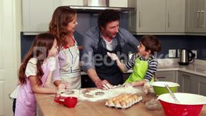 Happy family cooking biscuits together