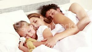 Happy family sleeping together