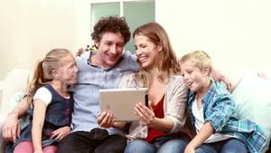 Happy family having video call with tablet