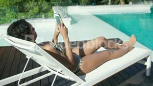 Smiling woman relaxing in deck chair
