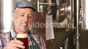 Brewery worker holding a beer