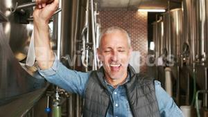 Brewery worker standing with thumbs up