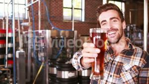 Brewery worker checking the product