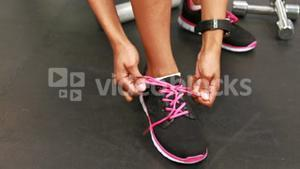 Fit woman tying his shoes