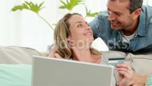 Smiling couple making online shopping