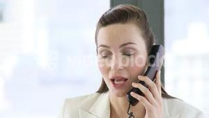 CEO talking on her cellular phone