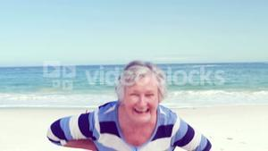Funny senior woman making faces to the camera