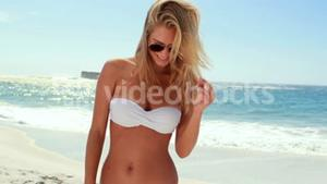 Attractive blonde with sunglasses at the beach