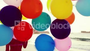 Attractive blonde holding balloons