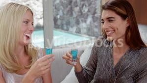 Happy women drinking shots
