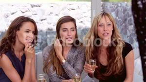 Smiling women drinking champagne glass