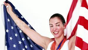 Happy athlete holding American flag