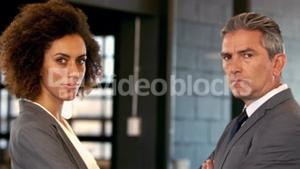 Face to face between serious businessman and businesswoman