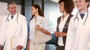 Doctors and businesswomen walking and talking together