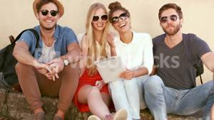 Smiling hipster friends looking at camera