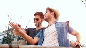 Smiling hipster friends with map