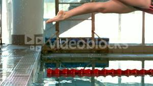Fit woman diving into pool