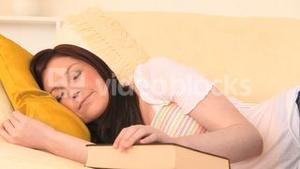 Attractive darkhaired woman taking a nap