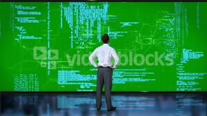 Businessman coding on green interface