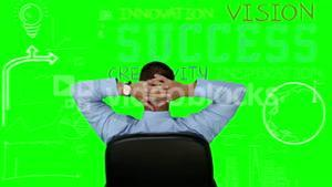 Businessman sitting and looking at green interface