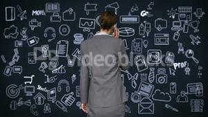 Businesswoman on the phone facing tech interface