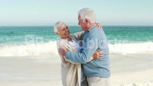 Retired old couple embracing each other