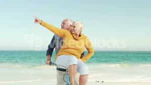 Retired old couple on a bike