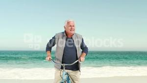 Retired old man on bike pointing the sky