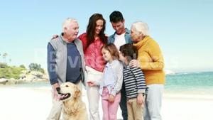 Three smiling generation family with dog