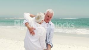 Old retired couple dancing together