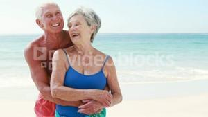 Old retired couple embracing each other