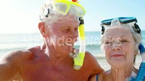 Smiling old retired couple with mask and snorkel