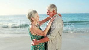 Retired old couple dancing together