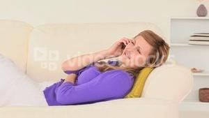 Relaxed woman talking on the phone