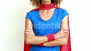 Serious woman with superman disguise