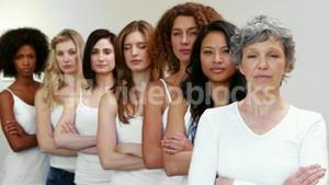 Serious women standing in a row
